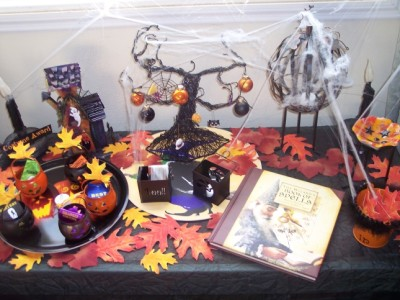 table filled with Halloween decorations.