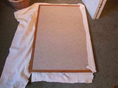 Cover front of cork board with a second layer of batting, and wrap around the sides and attach to the back.