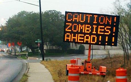 neon zombies ahead sign