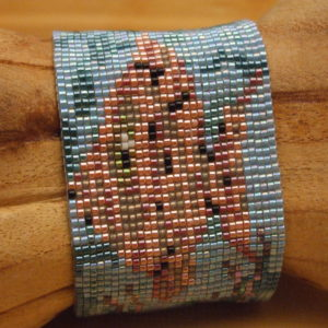 Close-up of fish in the Under the Seas loom woven bead pattern.