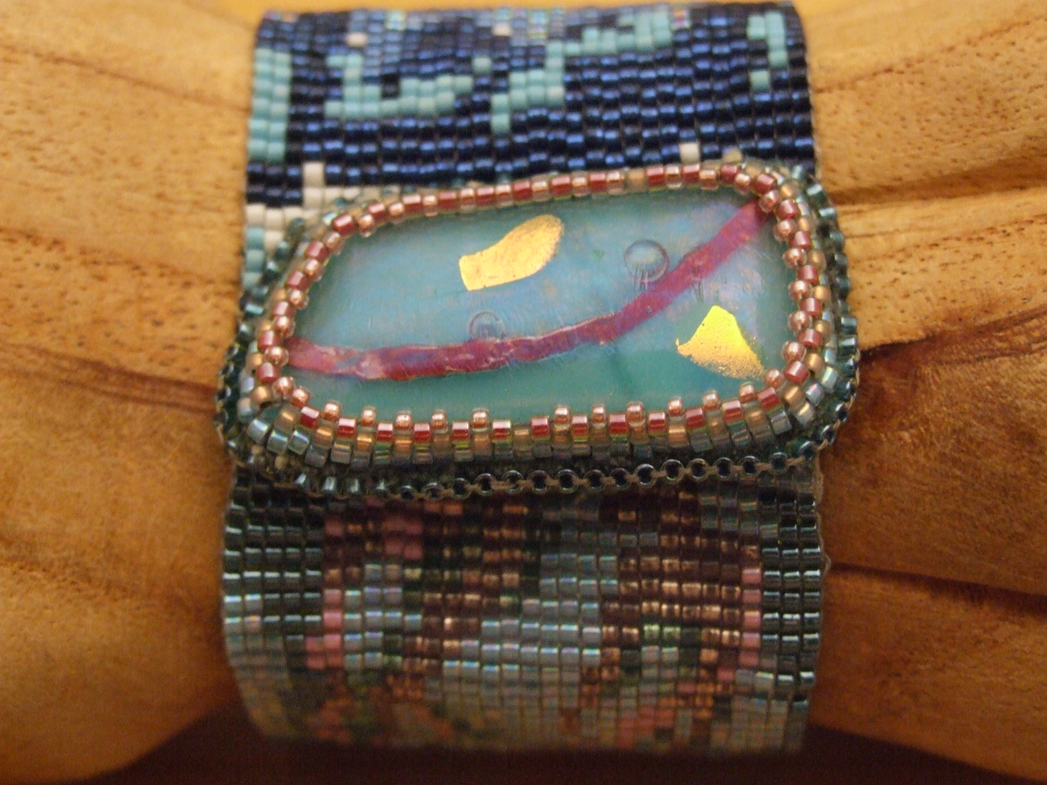 Loom woven beaded bracelet, with fused glass clasp by Lynn Smythe, made with Miyuki Delicas.