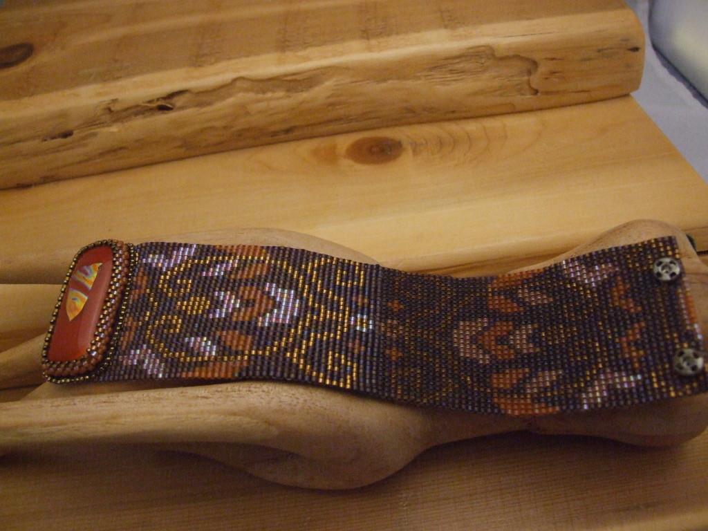 Handmade loom woven bracelet featuring Miyuki Delica beads.