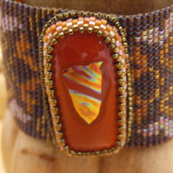 Close-up of fused glass cabochon clasp by Lynn Smythe.