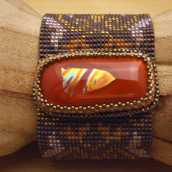 Loom woven beaded bracelet with fused glass clasp created by Lynn Smythe.