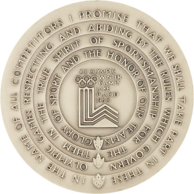 Reverse side of 1980 Winter Olympics participation medal.