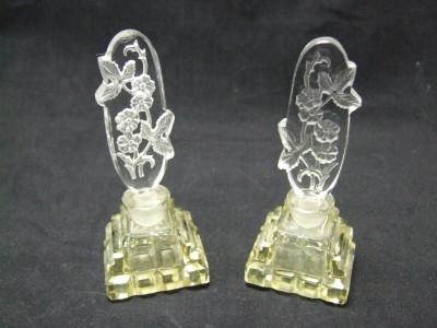 Pair of vintage cut glass perfume bottles.