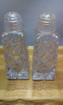 Pressed glass salt and pepper shakers.
