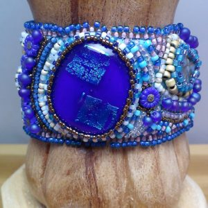 Close up of one of my fused glass cabochons incorporated into the bracelet