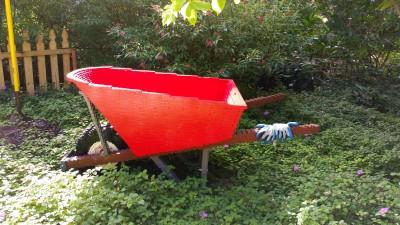 Sean Kenney Lego wheelbarrow sculpture.